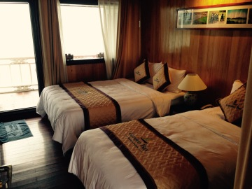 Balcony cabin on Garden Bay Cruise Halong Bay