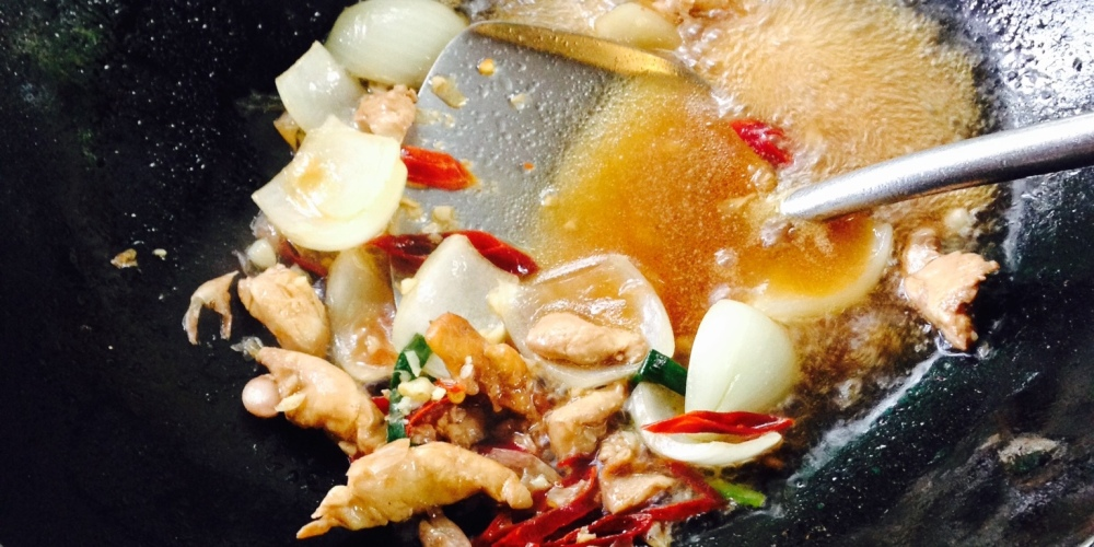 Cooking chicken with cashew nut in a wok