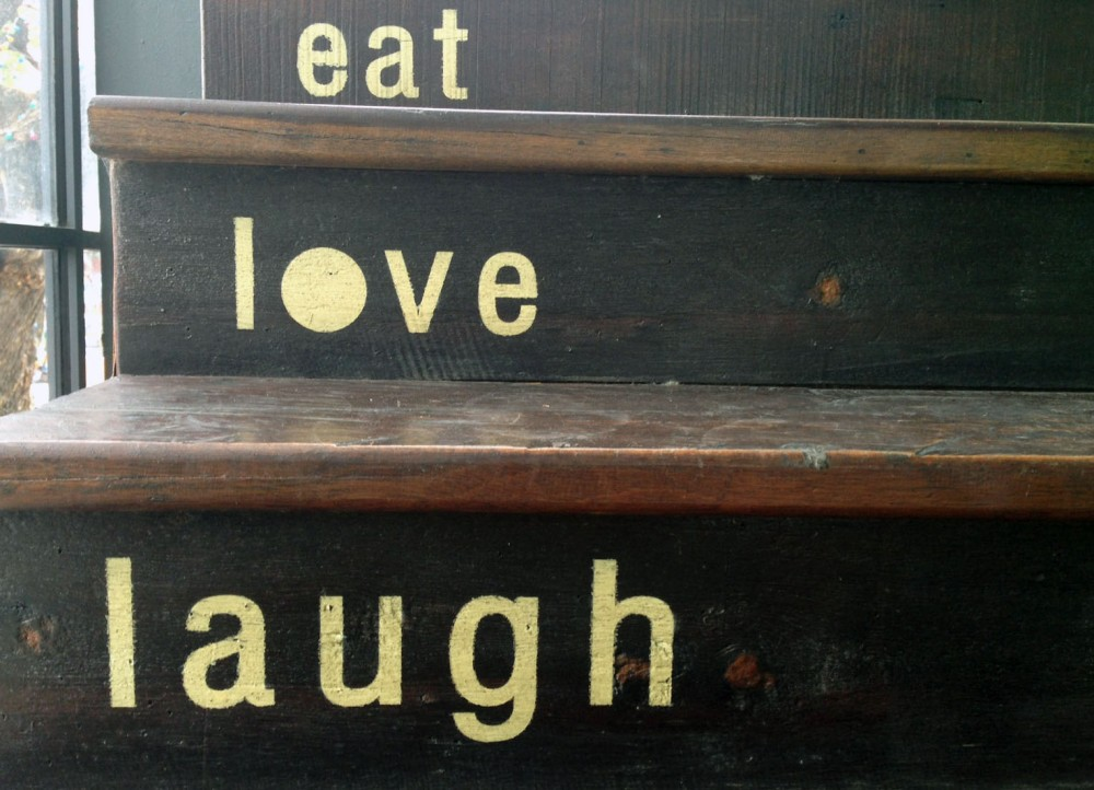 Eat love laugh words on step